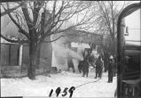 Fire department putting out a fire, 1959