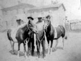 Two men and their horses in front of the Valley Hotel