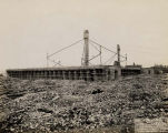 Field Museum construction site photograph view of debris and lumber stockpiles with construction...