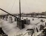 Field Museum construction site photograph --close-up of part of crane with southwestern cityscape...