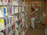 shelving books at Glenview Public Library