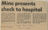 1968.2.Building.1 Mine presents check to hospital