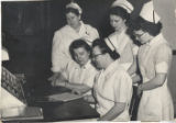 1952.1.4 Graham Hospital School of Nursing students at OB report