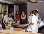1973.23.10 Graham Hospital School of Nursing career day patient care activity
