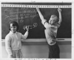 Students at Chalkboard During Math Class