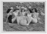 Eureka Pumpkin Festival Queen  and attendants pose in local pumpkin field, 1949.