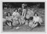 Eureka Pumpkin Festival Queen and attendants carving pumpkins in local field, 1949.