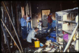Law enforcement personnel investigating the scene of the April 19, 1989 firebombing of the Joliet...
