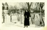 Photograph of Nellie Fisk standing next to a chicken coop that came with the house at 420...