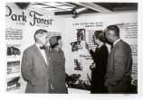 Jack Rashkin, ACB sales director, with a couple in front of a display board