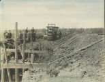 Men standing in a College Hill construction site.