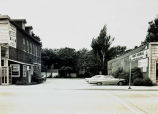 Parking Lot between Duffys Tavern and Hahns Hardware Photograph, circa 1960