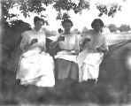 Photograph of three Sachs women relaxing in hammock, ca 1910