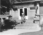 Carnegie Library of Wilmette front steps with four patrons