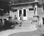 Carnegie Library of Wilmette front steps with three patrons