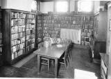 Carnegie Library of Wilmette interior showing crowded shelves.