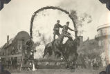 Soldiers on Horseback Jumping Through a Ring of Fire